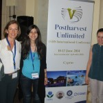 Maria Isabel Gil with Egli and Chrystalla in front of the Conference banner